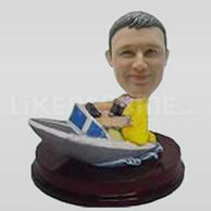 Custom man bobblehead driving a boat