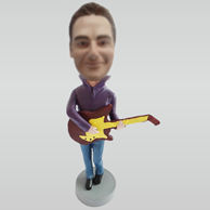 Custom man and guitar bobbleheads