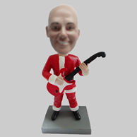 Custom Santa Claus and guitar bobbleheads