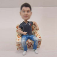Personalized custom man in sofa bobbleheads