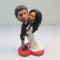 Customized happiness wedding cake bobblehead doll