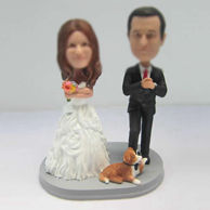 Personalized custom wedding cake with dog bobbleheads
