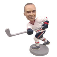Personalized custom ice hockey player hitting ball bobbleheads