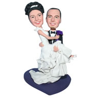 Groom in black suit carrying his bride in white wedding dress custom bobblehead