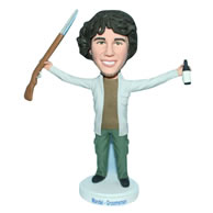 Black hair hunter handing a shotgun and a bottle bobblehead