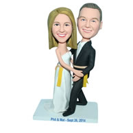 Groom in black suit and bride in white wedding dress bobblehead