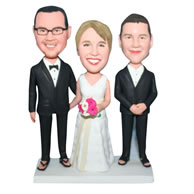Groom in black suit and bride in white wedding dress with their groomsman bobblehead
