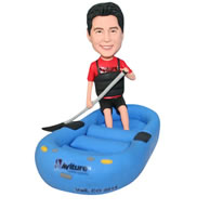 Man in red shirt playing kayaking bobblehead
