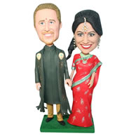 Groom in dark green long gown and bride in red dress bobblehead
