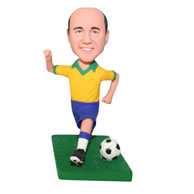 Man in yellow shirt playing soccer ball bobblehead
