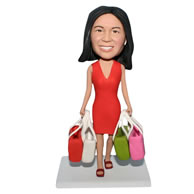 Red dress woman handing with multi shopping bags bobblehead