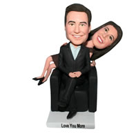 Husband in black suit and wife in coffee dress bobblehead