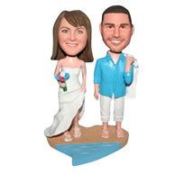 Groom in blue T-shirt and bride in white wedding dress on the beach bobblehead