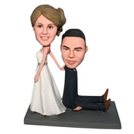 Funny groom in black suit and bride in white wedding dress bobblehead