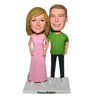 Husband in green shirt and wife in pink dress custom bobblehead