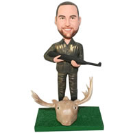 Custom  hunter in uniform handing a shotgun bobble head