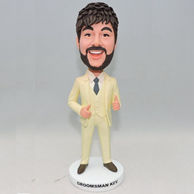 Groomsmen bobbleheads in yellow suit with grey tie