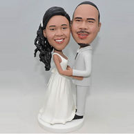 Custom bobbleheads in white dress and grey suit