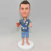 Personalized bobbleheads in blue beach shirt and shorts