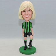 Football player bobbleheads for her in grreen jersey