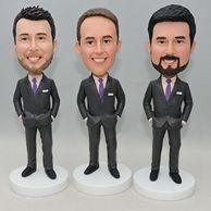 Groomsmen bobbleheads in grey suit and purple tie