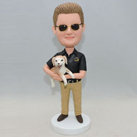 Custom bobblehead for husband with a dog in his hand