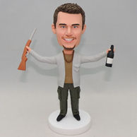 Custom man bobblehead holding a gun and a beer