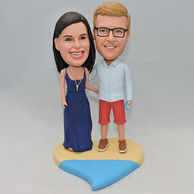 Sweet couple bobblehead standing on a colorful heart base