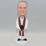 Personalized bobblehead with white cloke and a brown scarf