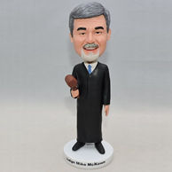 Personalized judge bobblehead with black outfit and a brown hammer