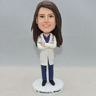 Friendly woman doctor bobblehead with dark blue outfit