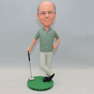 Personalized golf player bobblehead with two white ball on the green ground