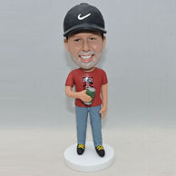 Personalized young man bbobbleehad with black Nike hat