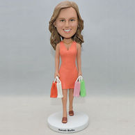 Beautiful lady bobblehead with several colorful shopping bag