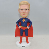Personalized superman bobblehead in red uniforms with a cloak