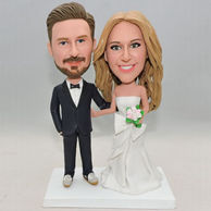 Personalized sweet wedding bobbheads with beautiful flowers