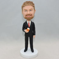Western-style clothes men bobblehead with a cup of tea on his hand