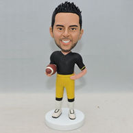 Personalized men bobbleheads with a rugby on his hand