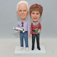 Custom old couple bobbleheads with something holding in hand
