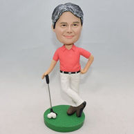 Personalized golf player bobblehead with three white ball on the green ground