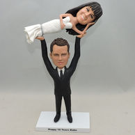 Personalized Couple Bobbleheads lifting his bride