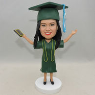Personalized Girl Bobblehead with green graduation uniform and hat