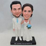 Custom Wedding Bobbleheads in white clothes holding blue flower