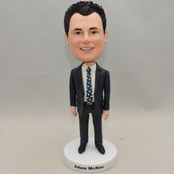 Custom-built smiling businessman bobbleheads with black suit