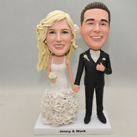 Personalized wedding bobbleheads hand in hand with sweet smile