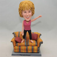 Woman bobblehead stand on sofa for funny