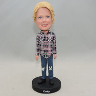 Little girl bobblehead with Plaid Shirt and big smile