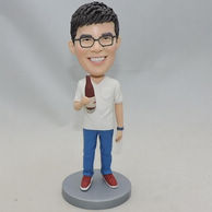 Peronalized man bobblehead holding bottle