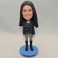 Graduated girl bobblehead with top boot and dark blue jacket