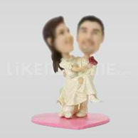 Custom bobblehead dolls of wedding cake toppers